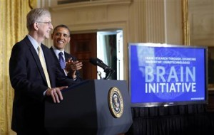 Obama is introduced by Francis Collins before his announcement of his administration's BRAIN initiative at the White House in Washington April 2, 2013