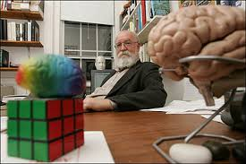 Daniel Dennett at his desk with a brain.