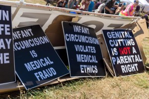 Foreskin Pride signs: Infant Circumkcision is Medical Fraud, Infant Circumcision Violates Medical Ethics, Genital Cutting is NOT a Parental Right